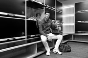 This image has been converted into black and white) Novak Djokovic of Serbia poses with the Norman Brookes Challenge Cup in the locker room after winning the Men's Singles Final against Dominic Thiem of Austria on day fourteen of the 2020 Australian Open at Melbourne Park on February 03, 2020 in Melbourne, Australia.