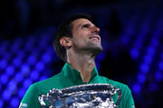 Novak Djokovic of Serbia poses with the Norman Brookes Challenge Cup after winning the Men's Singles Final against Dominic Thiem of Austria on day fourteen of the 2020 Australian Open at Melbourne Park on February 02, 2020 in Melbourne, Australia.