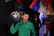 Novak Djokovic of Serbia walks onto Margaret Court Arena holding the Norman Brookes Challenge Cup after winning the Men's Singles Final against Dominic Thiem of Austria on day fourteen of the 2020 Australian Open at Melbourne Park on February 02, 2020 in Melbourne, Australia.