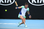 Carla Suarez Navarro of Spain plays a backhand during her Women's Singles first round match against Aryna Sabalenka of Belarus on day three of the 2020 Australian Open at Melbourne Park on January 22, 2020 in Melbourne, Australia.