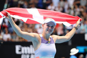 Caroline Wozniacki of Denmark drapes a Danish flag over her shoulders after losing her Women's Singles third round match against Ons Jabeur of Tunisia on day five of the 2020 Australian Open at Melbourne Park on January 24, 2020 in Melbourne, Australia.
