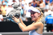 Caroline Wozniacki of Denmark holds aloft a cuddly koala after losing her Women's Singles third round match against Ons Jabeur of Tunisia on day five of the 2020 Australian Open at Melbourne Park on January 24, 2020 in Melbourne, Australia.