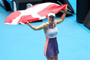 Caroline Wozniacki of Denmark drapes a Danish flag over her shoulders and acknowledges the crowd after losing her Women's Singles third round match against Ons Jabeur of Tunisia on day five of the 2020 Australian Open at Melbourne Park on January 24, 2020 in Melbourne, Australia.
