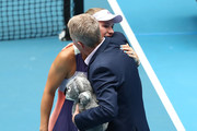 Caroline Wozniacki of Denmark embraces Tournament Director Craig Tilley following her Women's Singles third round match against Ons Jabeur of Tunisia on day five of the 2020 Australian Open at Melbourne Park on January 24, 2020 in Melbourne, Australia.