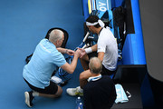 Fabio Fognini of Italy receives medical treatment during his Men's Singles fourth round match against Tennys Sandgren of the United States on day seven of the 2020 Australian Open at Melbourne Park on January 26, 2020 in Melbourne, Australia.