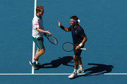 Pat Cash (R) and Mark Woodforde of Australia celebrate after winning a point in their Men's Legends Doubles match against Thomas Muster of Austria and Mats Wilander of Sweden on day eight of the 2020 Australian Open at Melbourne Park on January 27, 2020 in Melbourne, Australia.