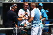 Pat Cash and Mark Woodforde of Australia shake hands with Thomas Muster of Austria and Mats Wilander of Sweden at the net following their Men's Legends Doubles match on day eight of the 2020 Australian Open at Melbourne Park on January 27, 2020 in Melbourne, Australia.