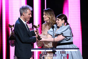 (L-R) Ronald Bronstein accepts the Best Editing award for 'Uncut Gems' from Olivia Wilde and Beanie Feldstein onstage during the 2020 Film Independent Spirit Awards on February 08, 2020 in Santa Monica, California.