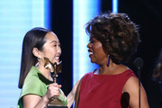 Lulu Wang accepts the Best Supporting Female award for 'The Farewell' on behalf of winner Zhao Shuzhen from Alfre Woodard onstage during the 2020 Film Independent Spirit Awards on February 08, 2020 in Santa Monica, California.