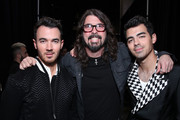 Retransmission with alternate crop.) (L-R) Kevin Jonas, Dave Grohl, and Joe Jonas attend MusiCares Person of the Year honoring Aerosmith at West Hall at Los Angeles Convention Center on January 24, 2020 in Los Angeles, California.