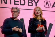 Ross Kauffman and Patricia Clarkson speak onstage during the 2020 Sundance Film Festival Awards Night Ceremony at Basin Recreation Field House on February 01, 2020 in Park City, Utah.