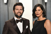 Adam Scott and Naomi Scott attend the 2020 Vanity Fair Oscar Party hosted by Radhika Jones at Wallis Annenberg Center for the Performing Arts on February 09, 2020 in Beverly Hills, California.