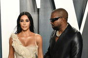 (L-R) Kim Kardashian and Kanye West attend the 2020 Vanity Fair Oscar Party hosted by Radhika Jones at Wallis Annenberg Center for the Performing Arts on February 09, 2020 in Beverly Hills, California.