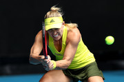Angelique Kerber of Germany plays a backhand in her Women's Singles first round match against Bernarda Pera of The United States of America during day one of the 2021 Australian Open at Melbourne Park on February 08, 2021 in Melbourne, Australia.