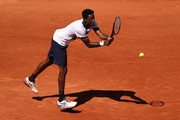 Gael Monfils of France plays a backhand in their mens first round match against Albert Ramos Vinolas of Spain during day three of the 2021 French Open at Roland Garros on June 01, 2021 in Paris, France.