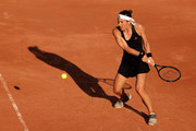Andrea Petkovic of Germany plays a backhand in their ladies first round match against Karolina Muchova of the Czech Republic during day three of the 2021 French Open at Roland Garros on June 01, 2021 in Paris, France.