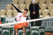 Carla Suarez Navarro of Spain reacts following defeat in their ladies first round match against Sloane Stephens of The United States during day three of the 2021 French Open at Roland Garros on June 01, 2021 in Paris, France.