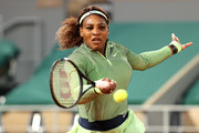 Serena Williams of The United States plays a forehand  in their ladies singles first round match against Irina-Camelia Begu of Romania on day two of the 2021 French Open at Roland Garros on May 31, 2021 in Paris, France.