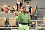 Serena Williams of The United States reacts to an empty stadium as she celebrates victory in their ladies singles first round match against Irina-Camelia Begu of Romania on day two of the 2021 French Open at Roland Garros on May 31, 2021 in Paris, France.