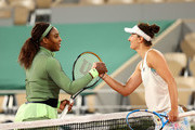 Irina-Camelia Begu of Romania congratulates Serena Williams of The United States on victory following their ladies singles first round match on day two of the 2021 French Open at Roland Garros on May 31, 2021 in Paris, France.