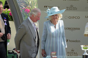 Prince Charles, Prince of Wales (L) and Camilla, Duchess of Cornwall award jockey Kevin Manning after he won the St James's Palace Stakes on Poetic Flare during Royal Ascot 2021 at Ascot Racecourse on June 15, 2021 in Ascot, England.