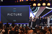 (L-R) Actor Ben Kingsley presents the the Best Picture award for 'Boyhood' to producer Cathleen Sutherland, producer Jonathan Sehring, actress Patricia Arquette, director/writer Richard Linklater, producer John Sloss, actor Ellar Coltrane, editor Sandra Adair, and actor Ethan Hawke onstage during the 20th annual Critics' Choice Movie Awards at the Hollywood Palladium on January 15, 2015 in Los Angeles, California.