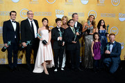 (L-R) Actors Ty Burrell, Ed O'Neill, Sarah Hyland, Nolan Gould, Julie Bowen, Rico Rodriguez, Eric Stonestreet, Sofia Vergara, Aubrey Anderson-Emmons, Ariel Winter, and Jesse Tyler Ferguson, winners of Outstanding Performance by an Ensemble in a Comedy Series for 'Modern Family,' pose in the press room during the 20th Annual Screen Actors Guild Awards at The Shrine Auditorium on January 18, 2014 in Los Angeles, California.