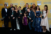 (L-R) Actors Ty Burrell, Ed O'Neill, Nolan Gould, Julie Bowen, Rico Rodriguez, Aubrey Anderson-Emmons, Eric Stonestreet, Jesse Tyler Ferguson, Sofia Vergara, Ariel Winter, and Sarah Hyland, winners of Outstanding Performance by an Ensemble in a Comedy Series for 'Modern Family,' pose in the press room during the 20th Annual Screen Actors Guild Awards at The Shrine Auditorium on January 18, 2014 in Los Angeles, California.