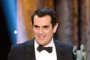 Actor Ty Burrell accepts the Outstanding Performance by a Male Actor in a Comedy Series award for 'Modern Family' onstage during the 20th Annual Screen Actors Guild Awards at The Shrine Auditorium on January 18, 2014 in Los Angeles, California.
