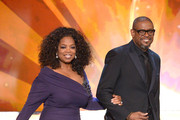 Actress-TV personality Oprah Winfrey and actor Forest Whitaker walk onstage during the 20th Annual Screen Actors Guild Awards at The Shrine Auditorium on January 18, 2014 in Los Angeles, California.