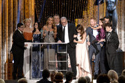 (L-R) Actors Rico Rodriguez, Julie Bowen, Ariel Winter, Sofia Vergara, Eric Stonestreet, Ed O'Neill, Jesse Tyler Ferguson, Sarah Hyland, Aubrey Anderson-Emmons, Nolan Gould, and Ty Burrell accept the Outstanding Performance by an Ensemble in a Comedy Series award for 'Modern Family' onstage during the 20th Annual Screen Actors Guild Awards at The Shrine Auditorium on January 18, 2014 in Los Angeles, California.