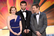 (L-R) Actors Amy Adams, Bradley Cooper and Jeremy Renner speak onstage during the 20th Annual Screen Actors Guild Awards at The Shrine Auditorium on January 18, 2014 in Los Angeles, California.