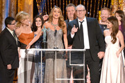 (L-R) Actors Rico Rodriguez, Julie Bowen, Ariel Winter, Sofia Vergara, Eric Stonestreet, Ed O'Neill, Jesse Tyler Ferguson, Sarah Hyland and Aubrey Anderson-Emmons accept the Outstanding Performance by an Ensemble in a Comedy Series award for 'Modern Family' onstage during the 20th Annual Screen Actors Guild Awards at The Shrine Auditorium on January 18, 2014 in Los Angeles, California.