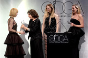 Actor Lily Tomlin, model Brooklyn Decker and actor June Diane Raphael present costume designer Jennifer Johnson (L) with the Excellence in Contemporary Film award for 'I, Tonya' onstage during the Costume Designers Guild Awards at The Beverly Hilton Hotel on February 20, 2018 in Beverly Hills, California.