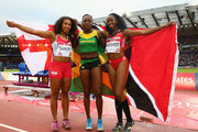 (L-R) Silver medalist Laura Samuel of England, gold medalist Kimberly Williams of Jamaica and bronze Ayanna Alexander of Trinidad and Tobago celebrate after the Women's Triple Jump final at Hampden Park during day six of the Glasgow 2014 Commonwealth Games on July 29, 2014 in Glasgow, United Kingdom.