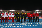(L-R) Silver medalists England, gold medalists Jamaica and bronze medalists Trinidad and Tobago pose during the medal ceremony for the Men's 4x100 metres relay at Hampden Park during day ten of the Glasgow 2014 Commonwealth Games on August 2, 2014 in Glasgow, United Kingdom.