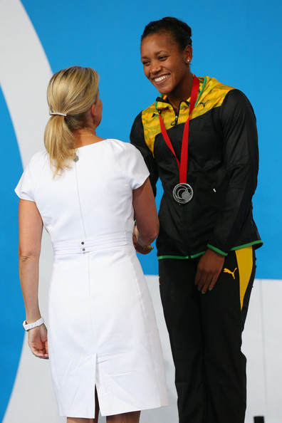 Silver medallist Alia Atkinson of Jamaica is presented with her medal by Sophie, Countess of Wessex during the medal ceremony for the Women's 50m Breaststroke Final at Tollcross International Swimming Centre during day two of the Glasgow 2014 Commonwealth Games on July 25, 2014 in Glasgow, Scotland.