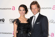 Kerry Norton and actor Jamie Bamber arrive at the 21st Annual Elton John AIDS Foundation's Oscar Viewing Party on February 24, 2013 in Los Angeles, California.