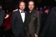 Actors Aaron Paul (L) and Jeremy Piven pose in the audience during the 21st Annual Huading Global Film Awards at The Theatre at Ace Hotel on December 15, 2016 in Los Angeles, California.