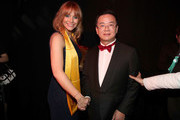 Bryce Dallas Howard (L) and festival founder Wang Haige pose backstage during the 21st Annual Huading Global Film Awards at The Theatre at Ace Hotel on December 15, 2016 in Los Angeles, California.