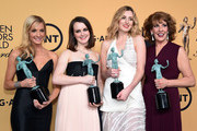 "(L-R) Actresses Joanne Froggatt, Sophie McShera, Laura Carmichael, and Phyllis Logan, winners of Outstanding Performance by an Ensemble in a Drama Series for ""Downton Abbey,"" pose in the press room during the 21st Annual Screen Actors Guild Awards at The Shrine Auditorium on January 25, 2015 in Los Angeles, California."