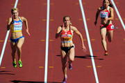 Verena Sailer(C) of Germany in between Nataliya Pohrebnyak (L) of Ukraine and Diane Borg (R) of Malta competes in the Women's 100 Metres Heats during day one of the 21st European Athletics Championships at the Olympic Stadium on June 27, 2012 in Helsinki, Finland.