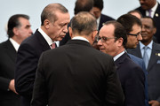 French President Francois Hollande (R) speaks with Turkish President Tayyip Erdogan before the Family Photo of the COP 21 on November 30, 2015 in Le Bourget, France. World leaders are meeting in Paris for the start of COP21, the two-week UN climate change summit, attempting to agree on an international deal to curb greenhouse gas emissions.