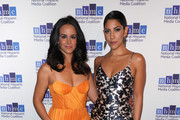 Actresses Melissa Fumero (L) and Stephanie Beatriz attend the 22nd Annual National Hispanic Media Coalition Impact Awards Gala at Regent Beverly Wilshire Hotel on February 22, 2019 in Beverly Hills, California.