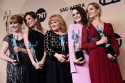 (L-R) Actors Phyllis Logan,  Raquel Cassidy, Lesley Nicol, Sophie McShera, and Joanne Froggatt, winners of  Outstanding Performance by an Ensemble in a Drama Series for 'Downton Abbey,' pose in the press room during the 22nd Annual Screen Actors Guild Awards at The Shrine Auditorium on January 30, 2016 in Los Angeles, California.