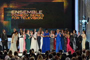 The cast of 'Orange Is the New Black,' including actors Vicky Jeudy, Lori Petty, Uzo Aduba, Kate Mulgrew, Annie Golden, Laura Prepon, Dale Soules, Laverne Cox, and Michelle Hurst, accept Outstanding Performance by an Ensemble in a Comedy Series award onstage at the 22nd Annual Screen Actors Guild Awards at The Shrine Auditorium on January 30, 2016 in Los Angeles, California.