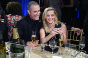 Jim Toth (L) and actor Reese Witherspoon attend The 23rd Annual Critics' Choice Awards at Barker Hangar on January 11, 2018 in Santa Monica, California.