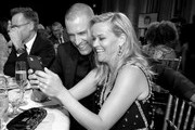 Image has been converted to black and white.)  Jim Toth (L) and actor Reese Witherspoon attend The 23rd Annual Critics' Choice Awards at Barker Hangar on January 11, 2018 in Santa Monica, California.