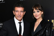 (L-R) Antonio Banderas, winner of the Hollywood Actor Award, and Dakota Johnson pose in the press room during the 23rd Annual Hollywood Film Awards at The Beverly Hilton Hotel on November 03, 2019 in Beverly Hills, California.