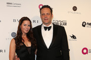 Actor Vince Vaughn (R) and Kyla Weber attend the 24th Annual Elton John AIDS Foundation's Oscar Viewing Party on February 28, 2016 in West Hollywood, California.